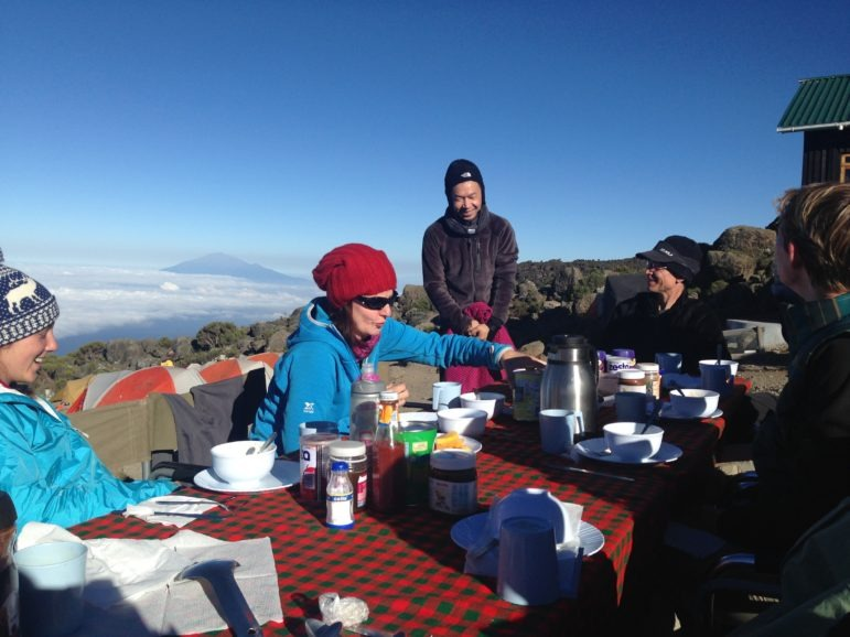 Eating at a table on a mountain