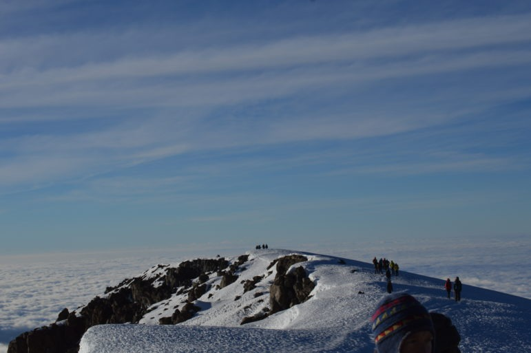Hikers making their way to the summit of Kilimanjaro