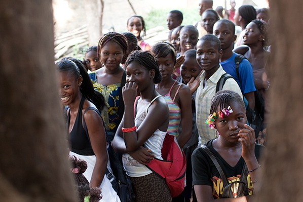 A group of people wait in line for NTD treatment in Mali before the COVID-19 pandemic.