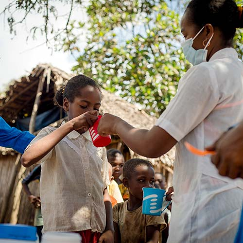 A child takes medicine during the mass drug administration in Madagascar.
