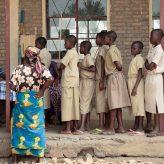 Children waiting in line for medicine