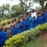Children in line for a mass drug administration in Rwanda for neglected tropical disease treatment